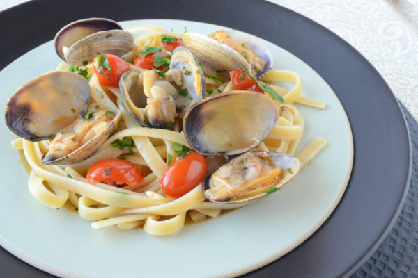 Linguine with White Clam Sauce and Tomatoes.